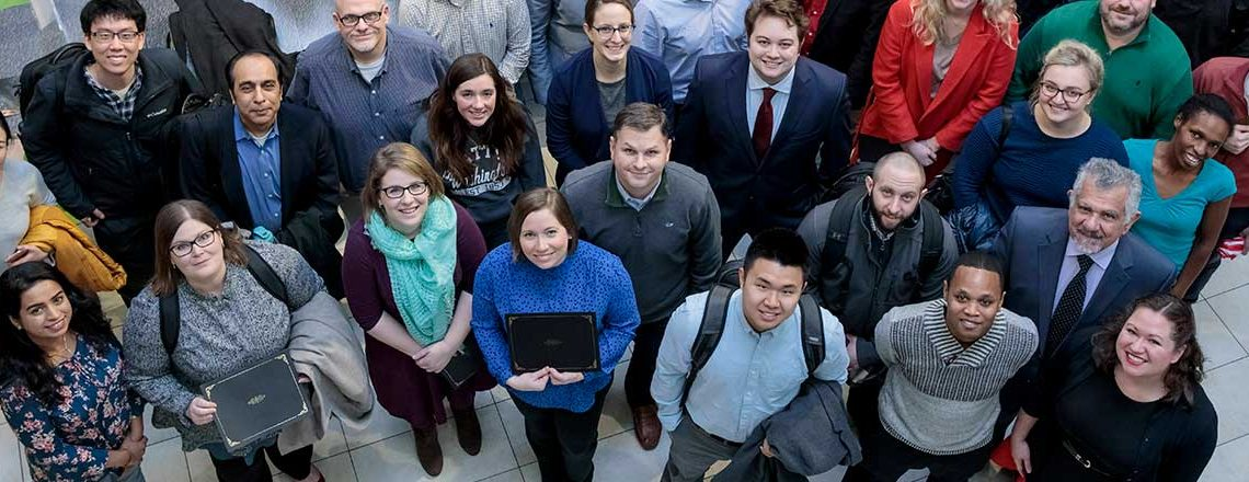 Group of WashU Boot Camp students standing outside together